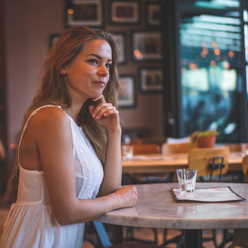 Woman Sitting at Coffee Shop